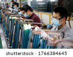 Small photo of Jiujiang, China - March 16, 2020: Workers assemble air conditioners exported to Europe at TCL Air Conditioner (Jiujiang) Co. Affected by coVID-19, TCL headquarters transferred orders from Wuhan to jiu