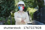 Virus and disease prevention concept. Portrait of a woman wearing a protective medical mask with an France flag. Protection against coronavirus and other diseases.