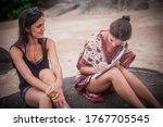 Two casual model girl signing model release in the nature on summer time. Photography modelling concept - stock photo