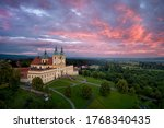 "Small photo of Aerial view on Pilgrimage Church of the Visitation of the Virgin Mary - pilgrimage site of European significance ""The Holy Hill"".Silhouette of basilica minor against pink evening clouds over landscape"