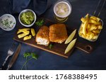 Small photo of Battered fish with french fries, mushy peas and sauce. Fish and chips, glass of beer. Overhead horizontal image