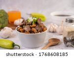 Small photo of Kuay Jab in a cup with pork Meatball and Pork Cracker. Thai food.