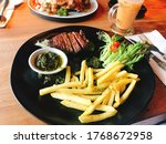 A Plate Of Steak Fries With...