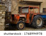 An Old Red Color Tractor  Fiel...