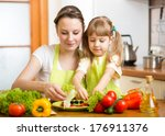 young mother and her kid making ... | Shutterstock . vector #176911376
