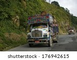 Small photo of BHUTAN - SEPTEMBER 28: Trucks on the road on September 28, 2013, Bhutan. The mountains make impossible to use rail in Bhutan, so traffic is exclusively by road. Trucks are used for carrying stuff.