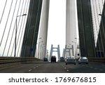 Small photo of Heavy vehicular traffic crossing Rajiv Gandhi Bandra-Worli Sea Link. It is a cable-stayed vehicular bridge connecting Northern Mumbai suburb Bandra with South Mumbai over Arabian Sea.