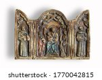 Small photo of triptych of polychrome religious plaster on white background, isolated on white background