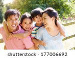 asian family enjoying walk in... | Shutterstock . vector #177006692