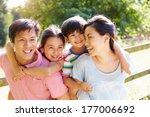 asian family enjoying walk in... | Shutterstock . vector #177006692