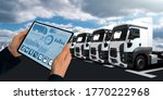 Small photo of Manager with a digital tablet on the background of semi trucks. Fleet management