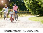 Asian Family On Cycle Ride In...