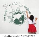 girl holding a paint brush... | Shutterstock . vector #177043292