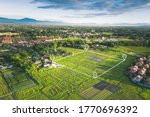 Small photo of Land plot in aerial view. Include landscape, real estate, green field, agricultural plant, pin location icon. For housing subdivision, residential, development, owned, sale, rent, buy or investment.
