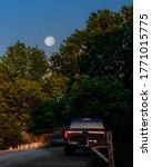 View Of Full Moon Rising As Sun ...