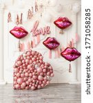Small photo of Festive Balloon Decorations for party or surprise. A huge heart filled with balloons, balloons in the shape of lips, love.