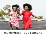 Afro Twins Sisters Running On...