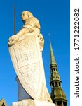 Small photo of Sculpture of Roland and St. Peter s Cathedral (Town Hall square, Riga, Latvia). Sculpture of Roland is an old symbol of judicial power, freedom and independence of many European cities.