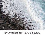 White Waves On Black Volcanic...