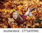 Kid Girl Lying On Leaves....
