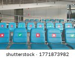New normal,Red symbol sticker placed on a chair, in the airport,distance for one seat from other people keep distance protect from COVID-19,coronavirus,social distancing,for infection risk,Thailand,