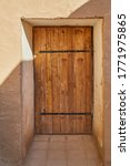 An Old Wooden Door On An Old...