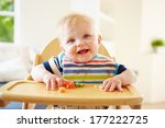 baby boy eating fruit in high... | Shutterstock . vector #177222725
