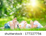 family lying on grass outdoors... | Shutterstock . vector #177227756