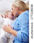 mother kissing baby girl as... | Shutterstock . vector #177228038