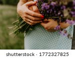Holding A Bouquet Of Lilac...