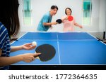 Couple Fun Playing Table Tennis ...