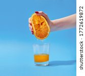 Female Hand Squeeze Orange On A ...