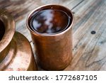 A Copper Water Holder And A...