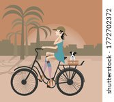 A Woman Biking With Her Dog O...