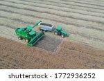 A Modern Green Tractor Stands...