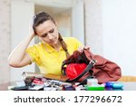 Small photo of Inconsiderate woman lost something and looking in her purse
