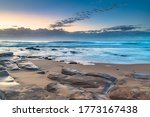 Rocks Uncovered On The Beach A...