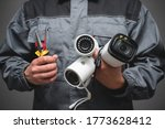 CCTV Installation Wizard concept. Service for installing CCTV cameras. - stock photo