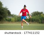 female soccer player on the... | Shutterstock . vector #177411152