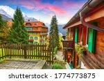 Fantastic autumn view of traditional swiss chalets in Wengen village. Picturesque Alpine village Wengen..  Location: Wengen village, Berner Oberland, Switzerland, Europe. - stock photo