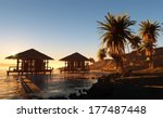 Huts And Palm Trees On The...