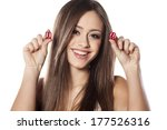 smiling girl holding a pair of...
