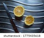 Lemon Slices And Wooden Knife...
