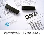 Small photo of Stone / UK - July 13 2020: Analog devices buys Maxim Integrated. Computer chips placed on top of Maxim Integrated and Analog devices technical documentation with schematics. Concept for merger.