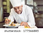 closeup of a smiling male chef... | Shutterstock . vector #177566885