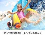 Little Girl On Slide At Water...