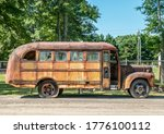 An Old Rusted School Bus With...