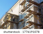 Worker On Scaffolding At...
