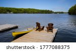 Two Adirondack Chairs On A...