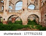 Small photo of Landscape of ruined buildings at sunset, image of decrepitude or natural disaster.